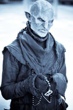 Bzok The Bleak - domesticated Goblin and follower of Aziz.