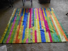 This is a rail quilt made with a Jelly Roll.  Fun to do.