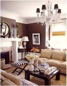 Chic & Eclectic Living room...mirror, Burberry throw, zebra and loose pillowed couch