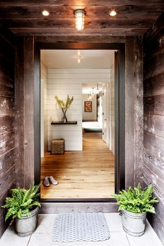 A reclaimed wood exterior opens into a warm entryway