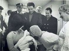 {*Elvis & Priscilla with Joe & Elvis's dad Vernon behind on the right leaving the Memphis hospital with little Lisa Marie Presley & the nurses saying goodbye, it's a shame they demolished that hospital so many memories ov the Elvis's family there*}