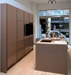 Contemporary kitchen cabinets with recessed handles and drawers that easy open by a slight touch create simple, clean, easy to use, safe and elegant kitchen design for modern homes and apartments.