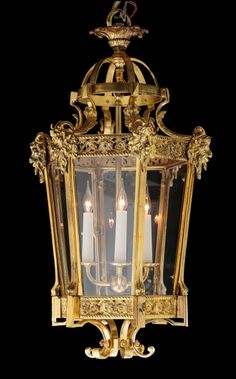 Hexagonal ramshead lantern. A decorative hexagonal solid cast brass lantern of tapered form with ramshead decorations, available with star cut glass. H 70cm W 40cm