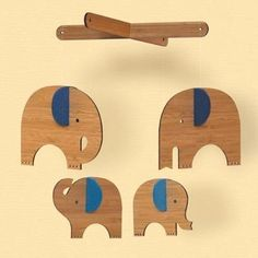 Petit Collage Blue Elephant Bamboo MobileMade of laser-cut sustainably harvested bamboo plywood.