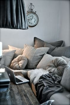 cozy. overdone in the best way: with pillows + throws