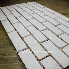 the coolest project I have seen in a while--a faux-brick wall made from foam and finished with spray paint | craft passion