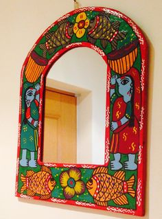 This is an original hand painted mirror frame with mirror portraying the art form of Janakpur, Nepal. The designs are full of life, bright