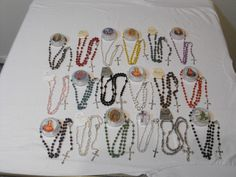 Wholesale lot of 18 assorted colorful rosaries. Wood and plastic.