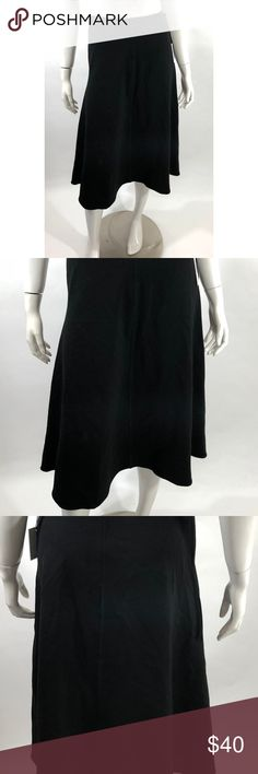 CK Flare Skirt 4 Solid Black Mid Calf Career NEW Calvin Klein Womens Flare Skirt Size 4 Solid Black Mid Calf Career NEW. Measurements: In inches Waist:28 Length:29 Calvin Klein Skirts A-Line or Full