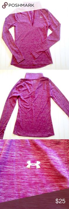 """NWOT Under Armour 1/4 zip Twist long sleeve top Purple-pink tone quarter zip long sleeve athletic top has reflective Under Armour symbol on front and back, openings in sleeves for thumbs and moisture wicking polyester to keep you cool when you're on the move!NWOT. Size XS, but may fit a small with stretch. Bust: 15.5"""" flat across. Length: 24"""". Feel free to ask questions or make an offer! Under Armour Tops Tees - Long Sleeve"""