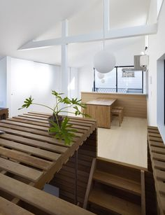 Switch Box in House by Naf Architect and Design - a house with a wooden box on the inside