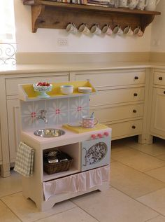 Handmade.  What a great kitchen for little girls.