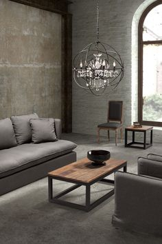 Modern rustic, urban, industrial combined with tailored elegance. Grays, wood tones, clean lines, with somethin' pretty.