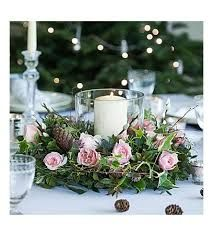 love this pretty christmas flower arrangement idea for a DIY centrepiece using pink roses, ivy, pine cones, pussy willow and foliage. Click through for more christmas flower arrangement DIY ideas you'll love to try for adding natural festive beauty this h Christmas Flower Arrangements, Flower Arrangements Simple, Christmas Flowers, Christmas Centerpieces, Pink Christmas, Floral Centerpieces, Christmas Wreaths, Christmas Decorations, Flower Table Decorations