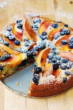 Delicious, light and fluffy Peach Blueberry Greek Yogurt Cake made in a springform baking pan. Greek yogurt gives cake a richer texture! Greek Yogurt Cake, Yogurt Pie, Yogurt Dessert, Just Desserts, Delicious Desserts, Yummy Food, Baking Recipes, Cake Recipes, Dessert Recipes