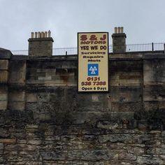 Signage. Leith. #signage #motor #mot #wall #greysky #chimneys #leith