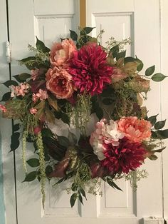 WILDLY ROMANTIC wreath is a lush and beautiful combination of peach peonies, hot pink dahlias, ivory hydrangea and blooming branches amid leafy greenery and trailing vines. Created on an 18grapevine base; recommended for interior or protected exterior use. Each wreath is custom made