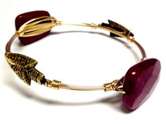 Show your spirit with Florida State Seminoles themed bangle bracelets, perfect for gameday! Each bangle is unique and made-to-order. Wire colors