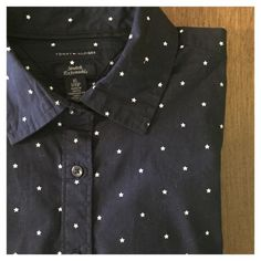 """Tommy Hilfiger Star Print Cotton Buttondown -- EUC Tommy Hilfiger Star Print Cotton Buttondown Sz XS --- Heavy Cotton w/ stretch --- 97% cotton 3% elastane --- Navy blue shirt with small white ditzy screen printed stars --- sleeves have three buttons at wrist and one extra button is included ---  bust 17"""" --- length 26"""" --- slim fit --- excellent used condition ---- thank you for visiting my boutique and please feel free to ask any questions  Tommy Hilfiger Tops Button Down Shirts"""