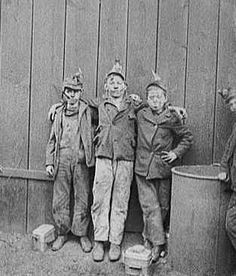 The work of a coal miner. Child labor.