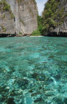 Phi Leh Bay at Koh Phi Phi Leh Thailand  Classic beaches, stunning rock formations, and vivid turquoise waters teeming with colourful marine life – it's paradise perfected.