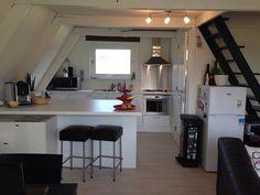 Cozy-A-Frame-Cottage-3.  White & Black A-frame Kitchen