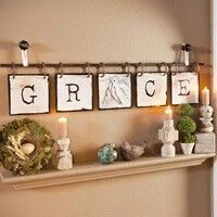 Hang letters or pictures on a curtain rod. With the letters spelling out Christmas above the mantle :)