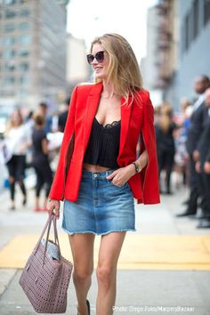 Try pairing a red blazer with a blue denim mini skirt and you'll look like a total babe. Elevate your getup with black leather pumps.   Shop this look on Lookastic: https://lookastic.com/women/looks/blazer-cropped-top-mini-skirt/13519   — Red Blazer  — Black Cropped Top  — Blue Denim Mini Skirt  — Black Leather Pumps  — Pink Leather Tote Bag  — Black Sunglasses