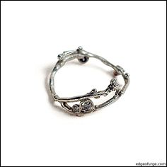 Love how delicate and earthy this is. Diamond Twig ring by Swallow