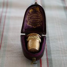 gold antique thimble and case