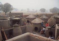 https://flic.kr/p/Dm1Dn | Compound | Chaian, Upper East Region, Ghana. The larger square quarters are for the head man, the double rounds with flat roofs for wives, the round thatched for animals and the small round for grain. This is taken in February during harmatan when the winds are blowing down from the Sahara Desert.