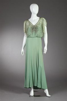 Celedon green evening dress, 1930s. The bodice with chiffon overlay and embellished with colorless rhinestones and beads.