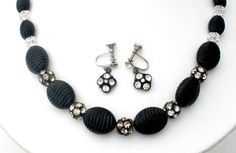 Vintage Beaded Jewelry - This is a vintage black lucite bead set with clear crystal spacers and rondelles. The rondelles are brass with all stones prong set. The necklace is 19 inches long and .63 inc