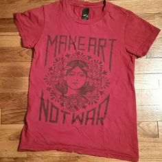 Obey Red Make Art Not War Tee Obey brand red tee with Make Art Not War on front. 7/10 condition because no tags, lightly worn, but has one mark. No other flaws.  100% Cotton Made in the USA  ✅Offer through the offer button, I always counter with my lowest (unless already at lowest) ✅Trades welcome ✅Bundle discounts- 10% off 2 or more items, larger discounts can be made for larger bundles just ask. Obey Tops Tees - Short Sleeve