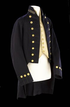 Royal Naval uniform: pattern 1805 National Maritime Museum. Full dress coat of naval surgeon Joshua Horwood. surgeon's mate HMS Prince at Trafalgar, promoted to surgeon 1807. Coat blue wool, felted finish, not a very high quality. Collar awkwardly cut and turned. Completely unlined, except for the sleeves lined with white cotton. Rank indicated by embroidered twist motifs in metal thread on both sides of the collar, and by the buttons which are a warrant officer.  Date made 	after 1807
