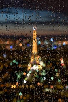 observando - Paris lights through windowed rain.