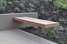 "Modern outdoor bench. Simple and functional. Also serves as a ""wall"" end of walkway near carport."