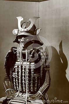 Samurai armor in a sitting position casts a shadow on a monochrome screen in black and white