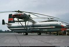 """Mil V-12 (Mi-12) - This very rare and unusual bird was nicknamed """"Homer"""" by the NATO and is by far one of the most exotic aircraft ever to have passed through the airport. It was accompanied by Mil Mi-8 CCCP-11097, both aircraft on their way to the Le Bourget airshow. Because they were not allowed to fly over Germany (Cold War issues), they had to re-route via Denmark and also The Netherlands to take on fuel. Currently, this airframe is preserved at the Air Force museum in Monino, Russia."""