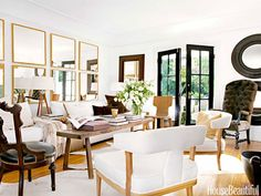 Honeyed wood tones add warmth to the black-and-white palette in the living room of designer Tobi Tobin's Hollywood Hills farmhouse.