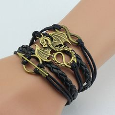 Game of Thrones Bracelets - Material: Zinc Alloy + Leather - Great gift piece for any Game of Thrones fan - Package includes 1 x Bracelet - Color: As seen in picture Shipping: Please allow up to 4 wee