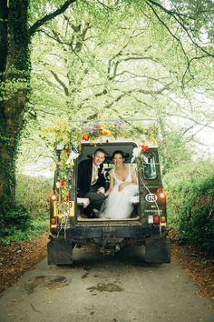 How it actually turned out: Wedding car. Uncle's Land Rover decorated with fresh flowers.