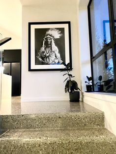 Polished concrete stairs in the grand entrance way of this home. Entrance Ways, Grand Entrance, Concrete Stairs, Concrete Floors, Polished Concrete, Showcase Design, Hand Blown Glass, Luxury Homes, Gallery Wall