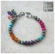 """Boho luxe stacking bracelet with faceted ruby, amythist, carnielian, matt pyrite, turquoise heishi, sterling silver, Swarovski crystal, and sterling wirewrapped gem and swarovski charms and lobster clasp. Fits a 6.5""""- 7"""" wrist. Can be adjusted, leave a note at checkout. - I love how this bracelet reminds me of the candy in the game! - Shown with a coordinating bracelet available separately in the shop."""