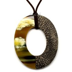 A beautiful pendant handmade from buffalo horn and ostrich leather. High polish finish. Lightweight. Actual colors may vary. 3.74 (9.5cm) length x 3.03