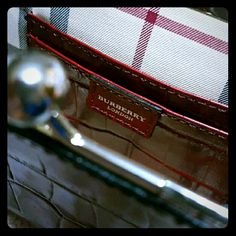 AutheBurberry Crocodile Embossed Clutch Authentic Burberry Red Crocodile Embossed Leather Clutch with Silver Ball Clasp. Interior is  Nova check with red crocodile embossed leather detailing.  Made in Italy.  Used a few times and in excellent condition; shows minimal signs of wear. No dustbag Burberry Bags Clutches & Wristlets