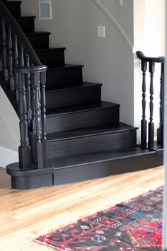 Black Stairs and a New (Old) Rug gray walls.