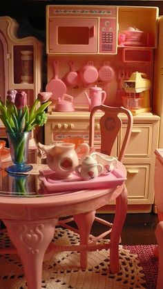 Barbie Sweet Roses Dining Table, Chairs and Cooking Center. I'm still a Barbie girl.