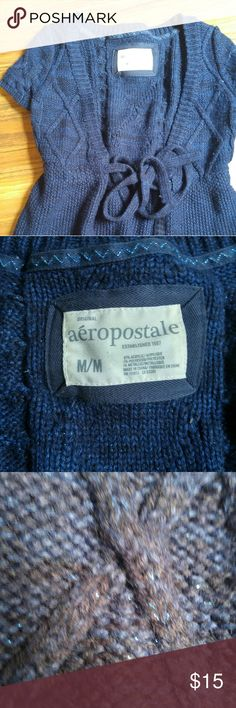 Short sleeve cardigan This is a short sleeve black and blue cardigan sweater with a wrap around the in the front. It does have some sparkle! Euc Aeropostale Sweaters Cardigans