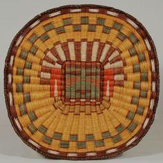 "#adobegallery - Hopi Third Mesa Wicker Pictorial Plaque. Weaver Unknown      Category: Trays and Plaques     Origin: Hopi Pueblo     Medium: Scrub sumac, Rabbit brush, Dye     Size: 14-1/4"" diameter     Item # 25738"